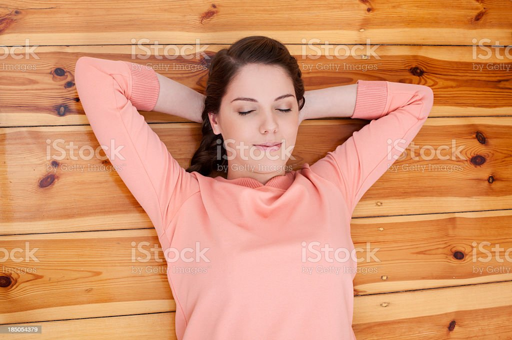 Young woman lying on floor royalty-free stock photo