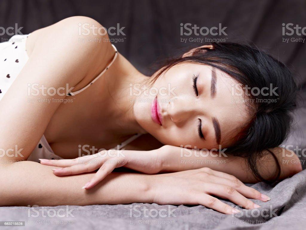 young woman lying on floor stock photo