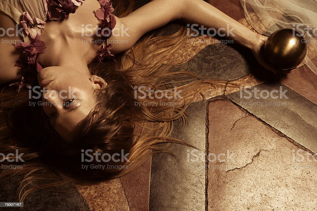 Young woman lying on floor 免版稅 stock photo