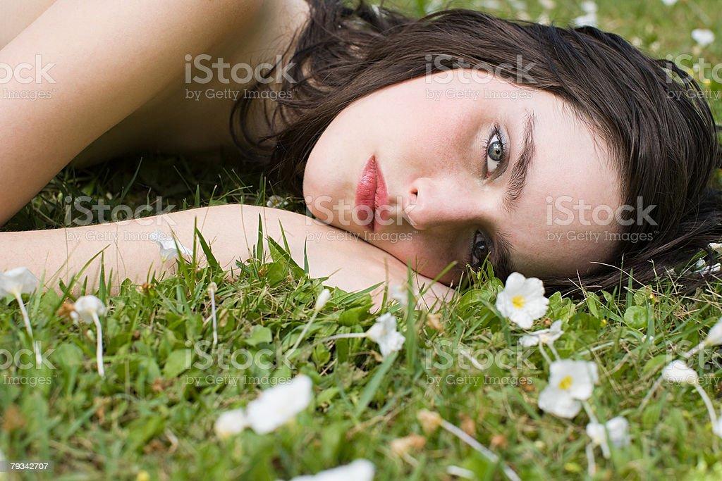 Young woman lying on grass 免版稅 stock photo