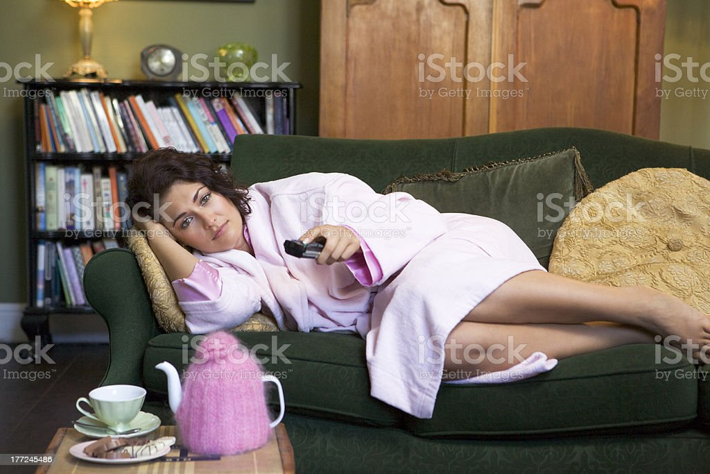 Young woman lying on her couch stock photo