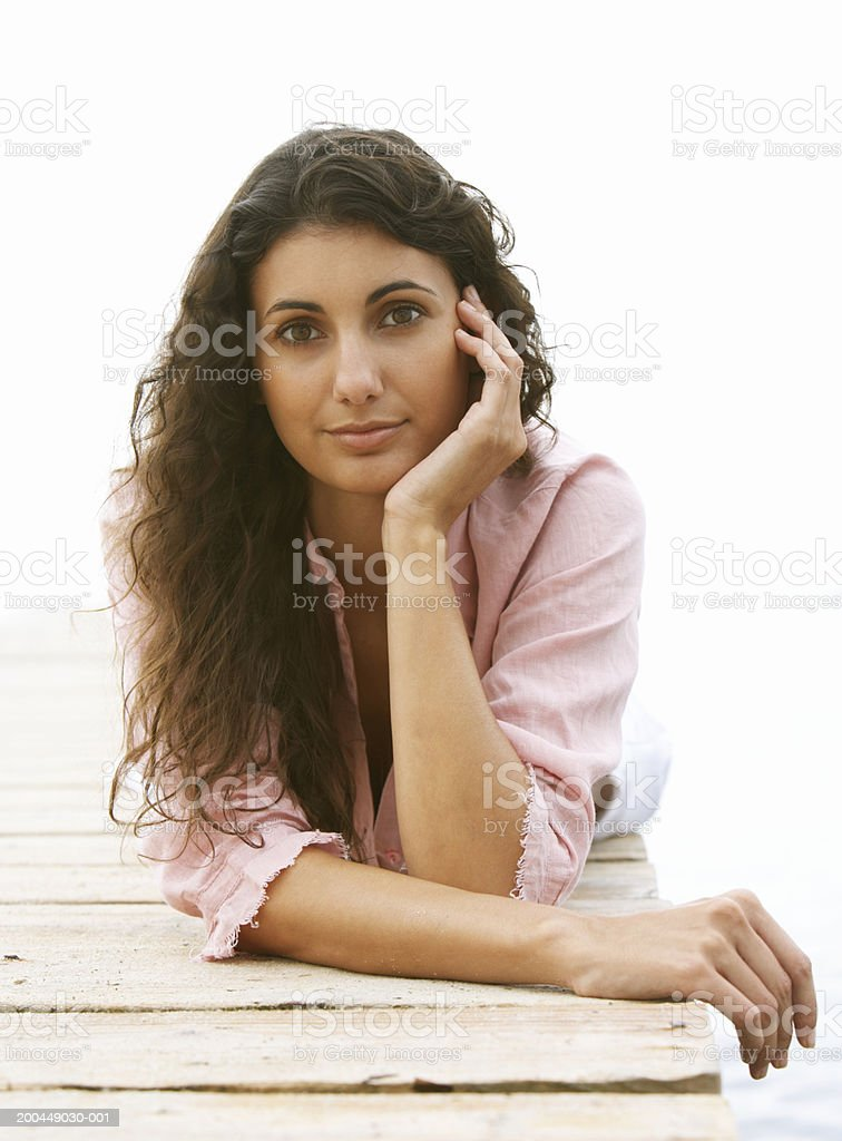 Young woman lying on jetty, portrait royalty-free stock photo