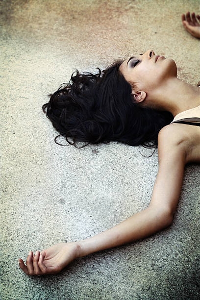 Young Woman Lying on Pavement stock photo