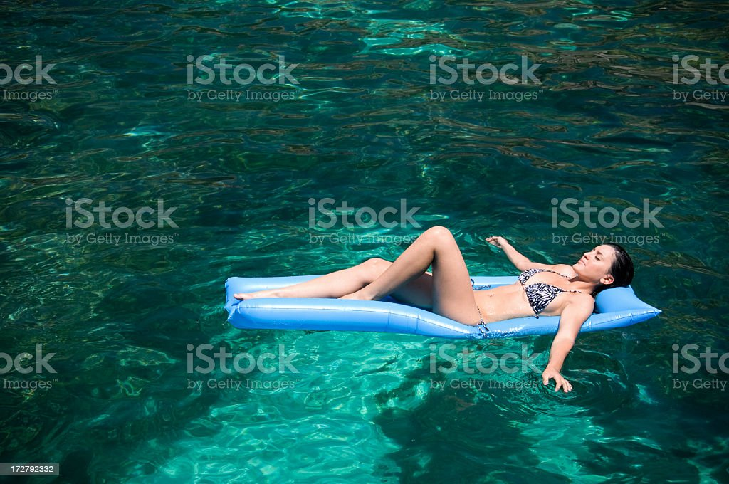 Young Woman Lying On Pool Raft, Summer vacation royalty-free stock photo