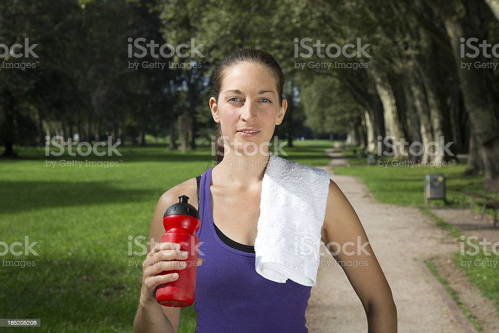 Young woman makes a break during sports royalty-free stock photo