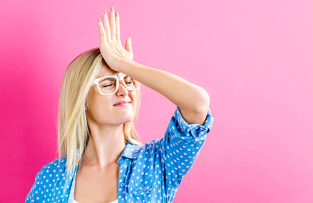 Young woman making a mistake stock photo
