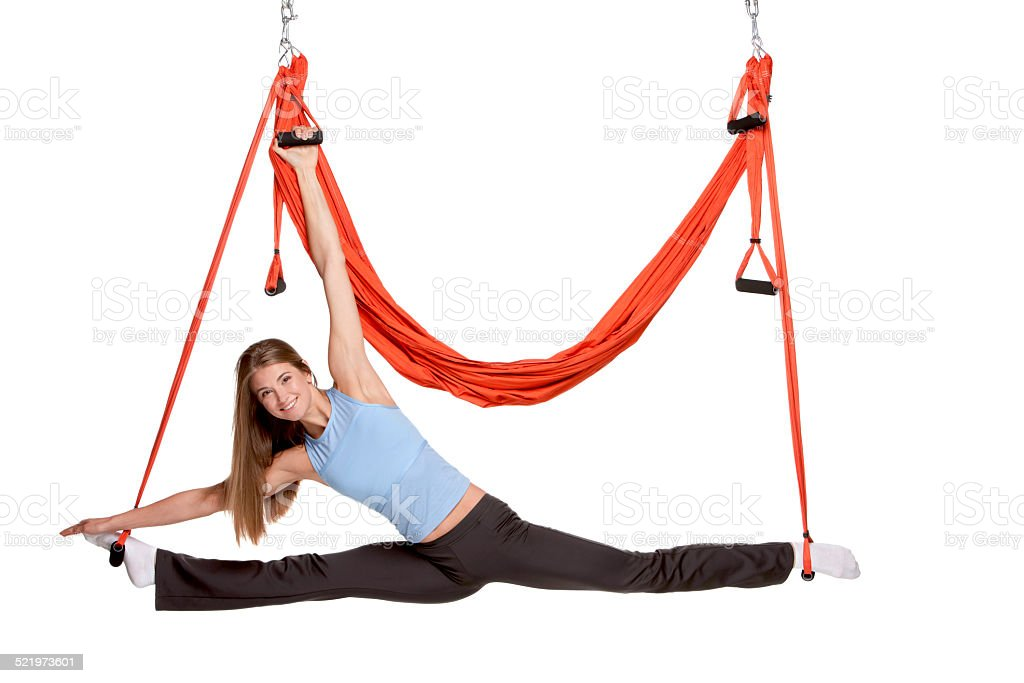 Young woman making antigravity yoga exercises in stretching twine stock photo