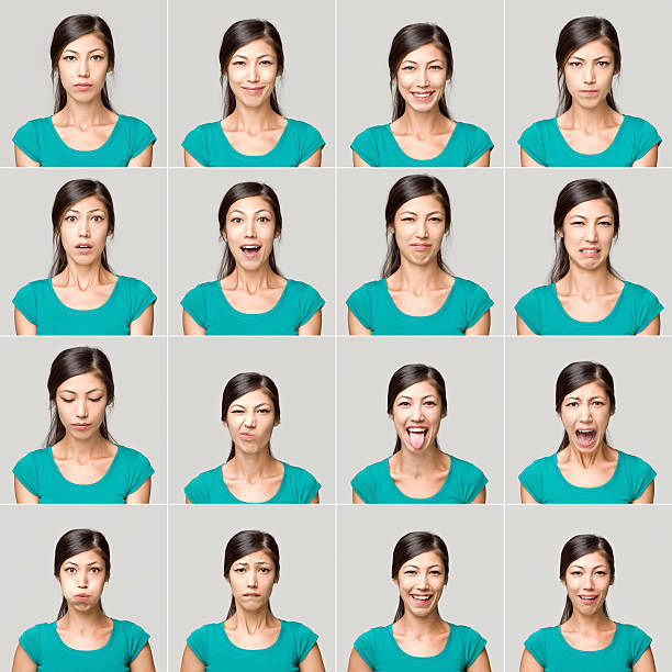 Young woman making facial expressions stock photo