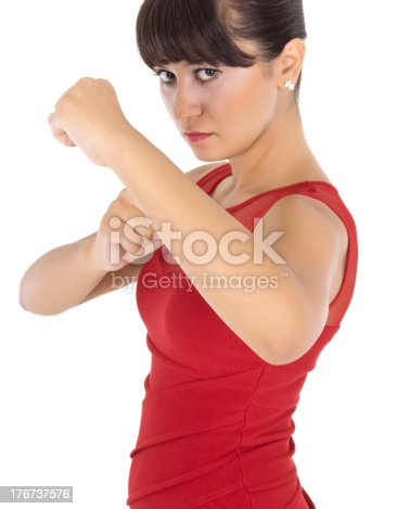 A young woman making fists in angst