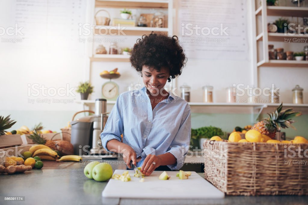 Young woman making fresh juice stock photo