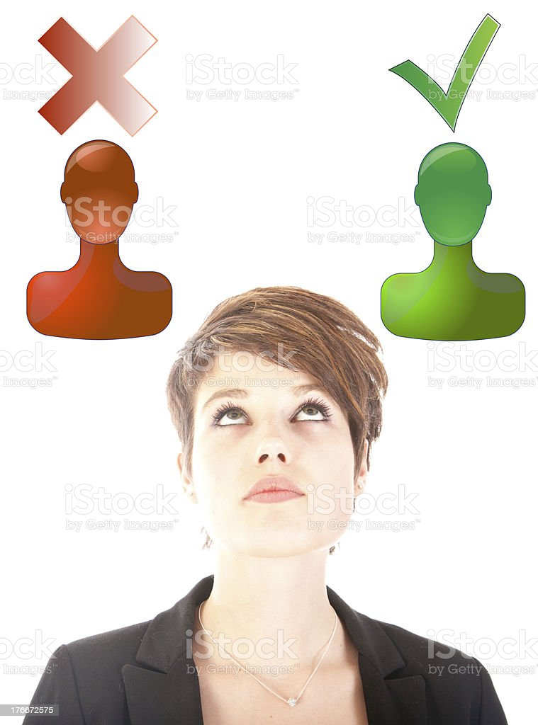 Young woman making good or bad choice isolated royalty-free stock photo