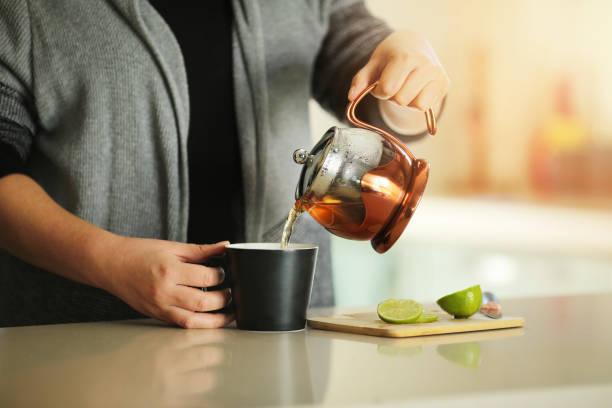 Young Woman Making Herbal Tea stock photo