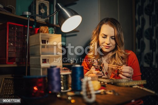 istock Young woman making jewelry in the workshop 960677036