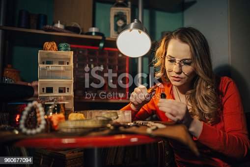 istock Young woman making jewelry in the workshop 960677094
