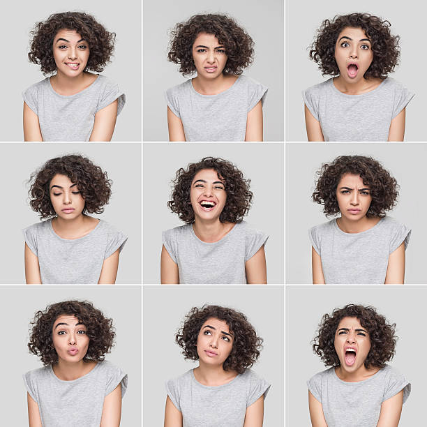 Young woman making nine different facial expressions stock photo