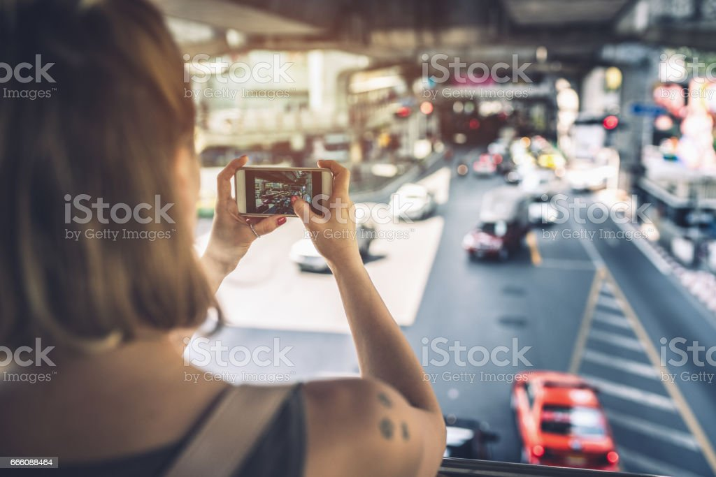Young woman making pictures of Bangkok streets stock photo