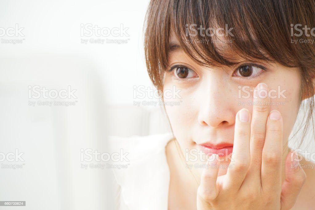 Young woman making up stock photo