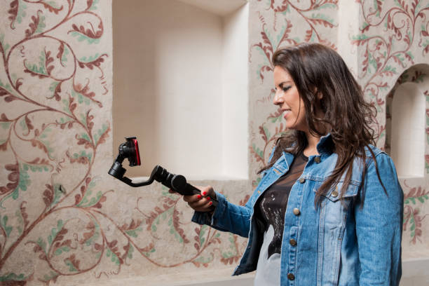 Young woman making video with gimbal steadicam for smartphone during a travel for social media stock photo