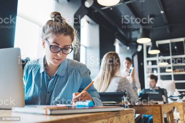 Young Woman Manager Doing Her Job Stock Photo - Download Image Now