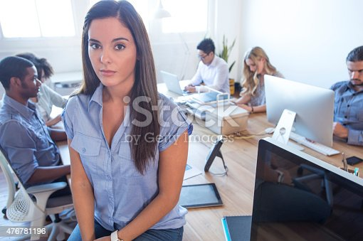 istock Young woman manager standing in front of her team. 476781196