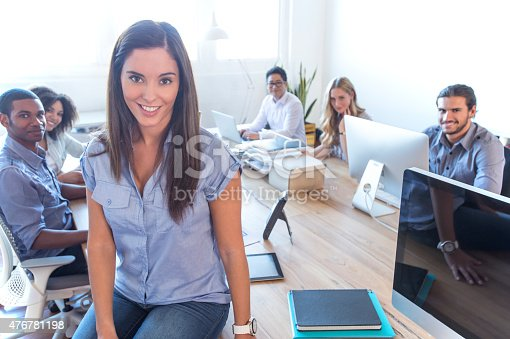629805626 istock photo Young woman manager standing in front of her team. 476781198
