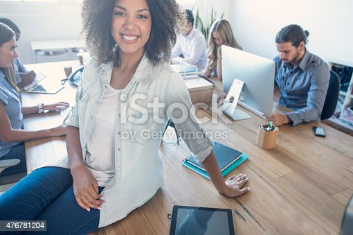 629805626 istock photo Young woman manager standing in front of her team. 476781204