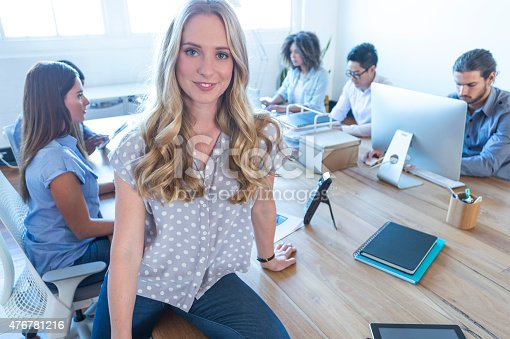 629805626 istock photo Young woman manager standing in front of her team. 476781216