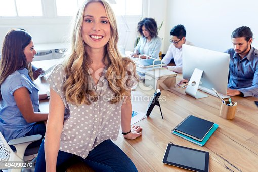 629805626 istock photo Young woman manager standing in front of her team. 494090270