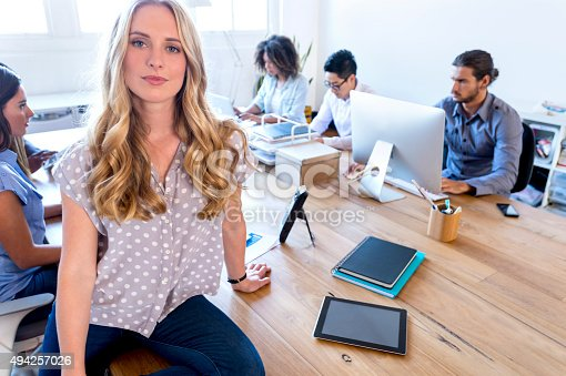 629805626 istock photo Young woman manager standing in front of her team. 494257026