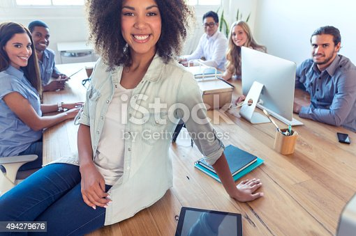 629805626 istock photo Young woman manager standing in front of her team. 494279676