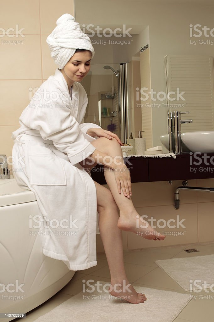Young woman massaging her feet stock photo