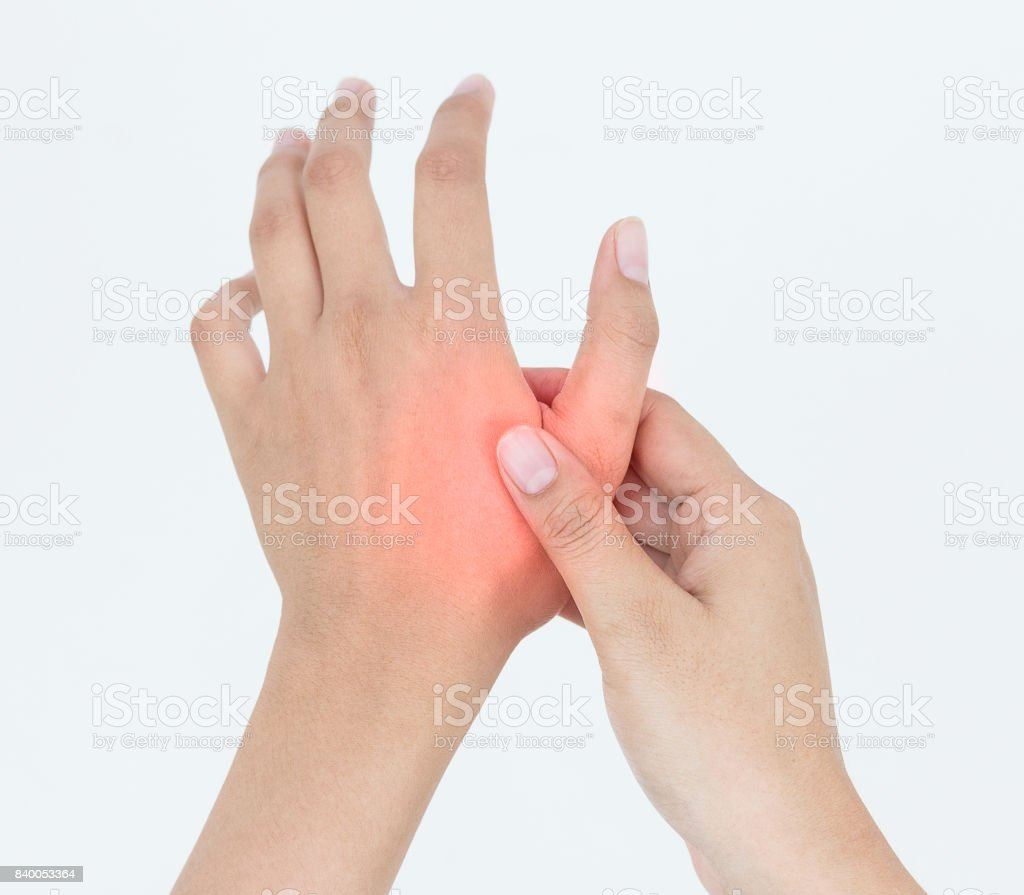 Young woman massaging her painful hand, suffering from hand pain isolated on a white background stock photo