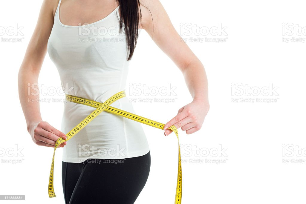Young woman measuring her waist royalty-free stock photo