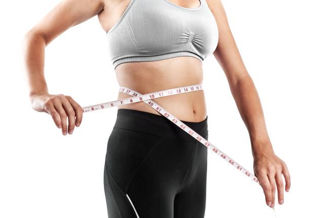 junge frau, die sich messen - damen leggings übergrößen stock-fotos und bilder