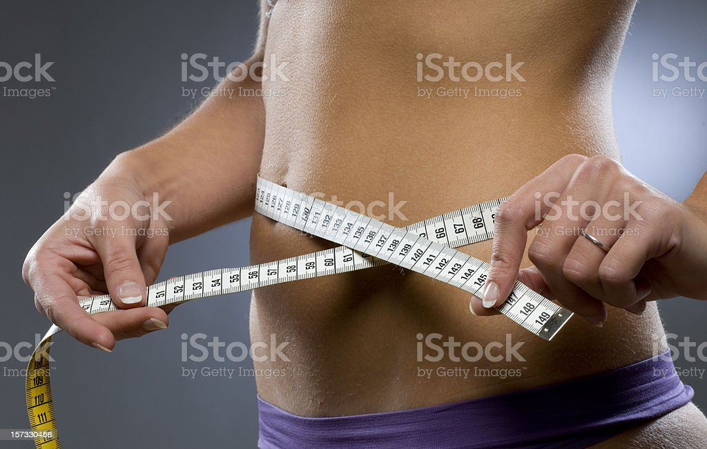 young woman measuring hips royalty-free stock photo