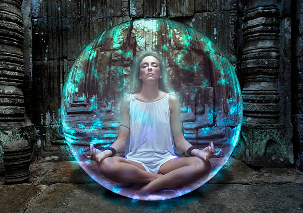 young woman meditates inside protective bubble - aura stock photos and pictures