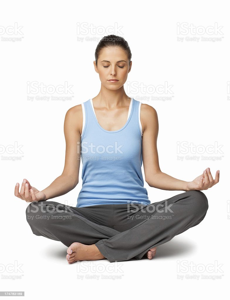 Young woman Meditating - Isolated stock photo