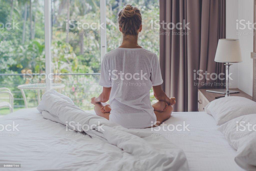 Young woman meditating stock photo