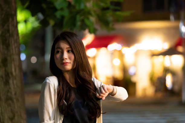 Young woman meeting up in the night cityscape background stock photo