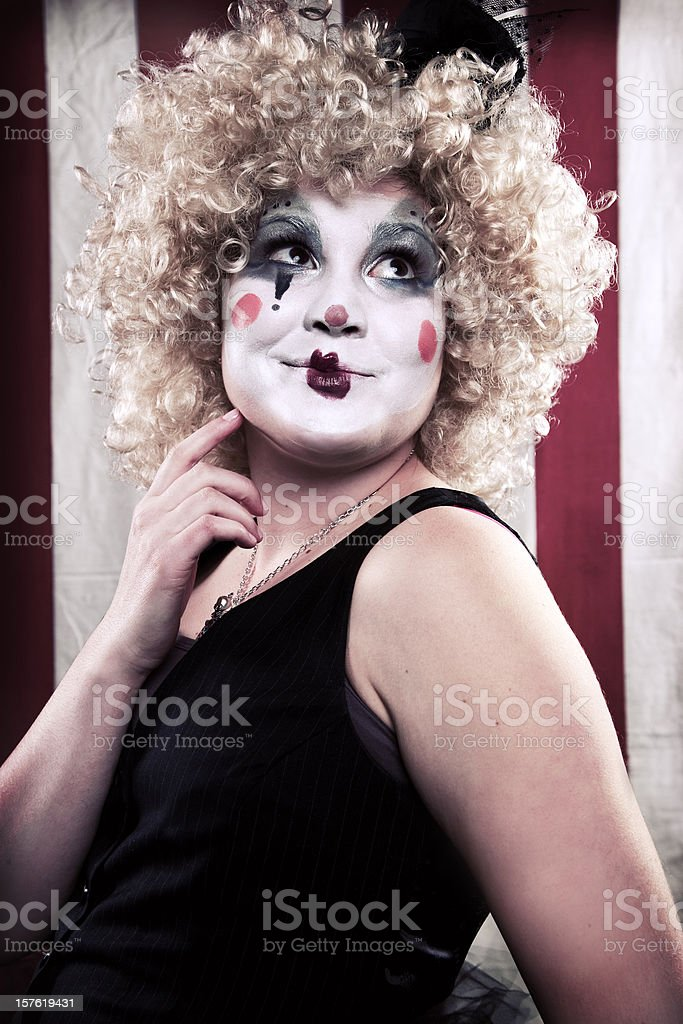 Young Woman Mime on Red and White Striped Background royalty-free stock photo