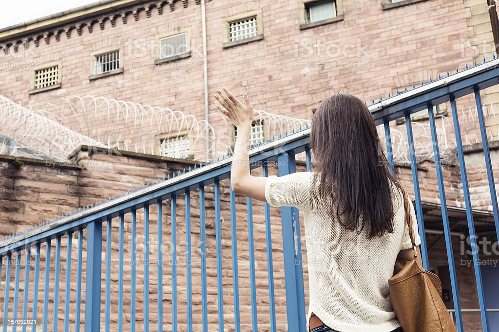 young woman misses her imprisoned boyfriend stock photo