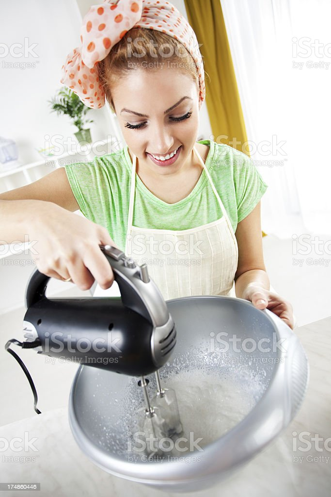 Young woman mixing of cream royalty-free stock photo
