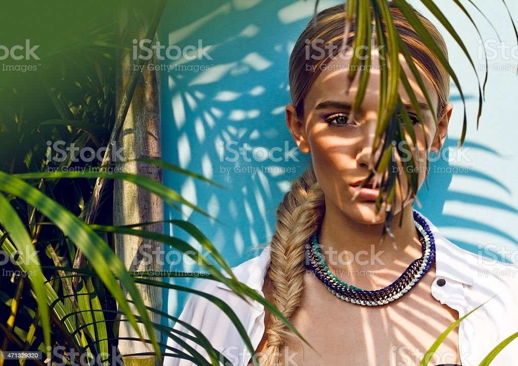 A young woman modeling as a jungle muse partially obscured stock photo