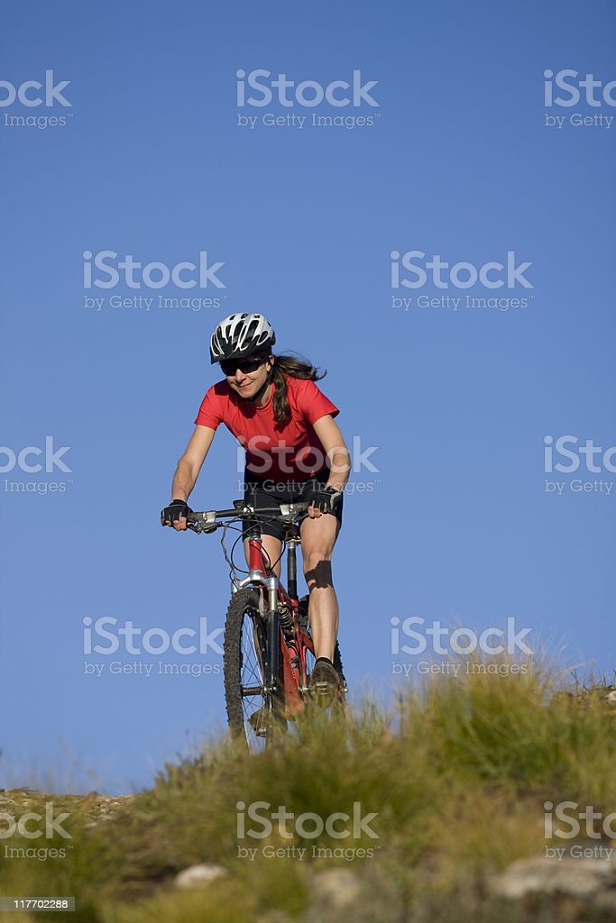 Young Woman Mountain Biking royalty-free stock photo