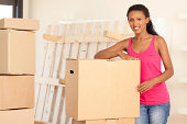 istock Young woman moving apartment. 184289523