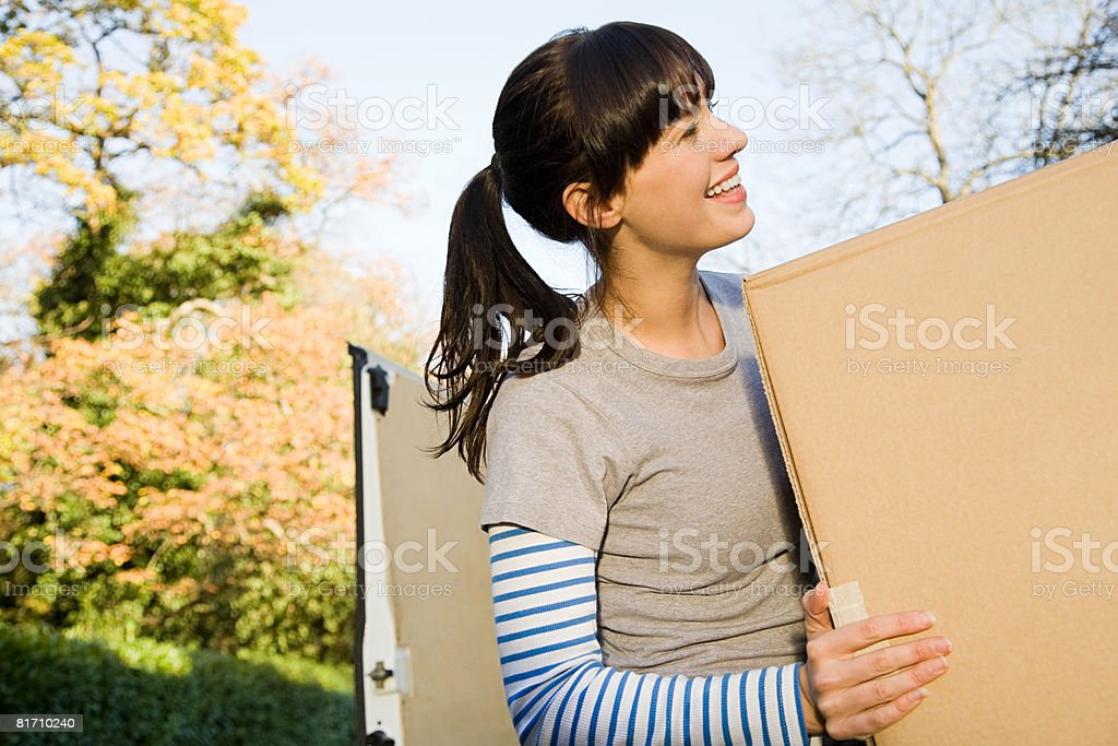 Young woman moving house royalty-free stock photo