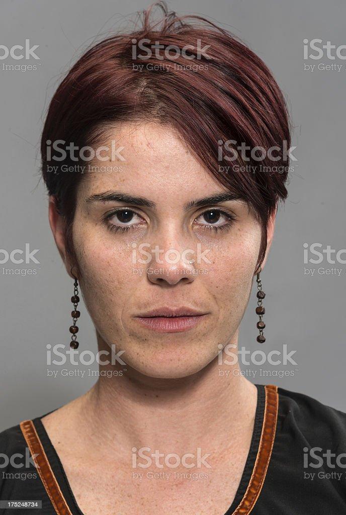 Young Woman Mug Shot on Gray Background