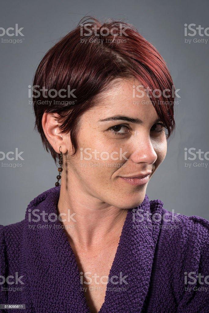 Young Woman smiling Mug Shot on Gray Background