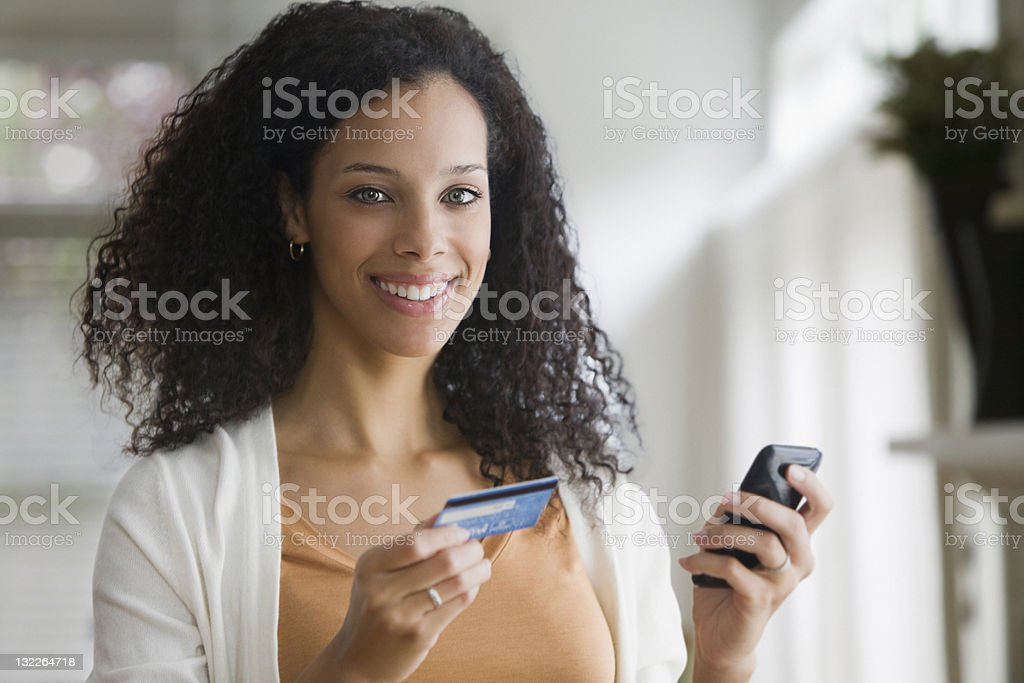 Young woman n mobile with credit card royalty-free stock photo