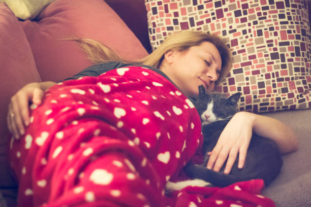 Young woman napping on the couch with her cat together picture id655761654?b=1&k=6&m=655761654&s=612x612&w=0&h=dmd hi2bfmcc3gp6l6sla24v0glbqklpzy1t u7dfwi=